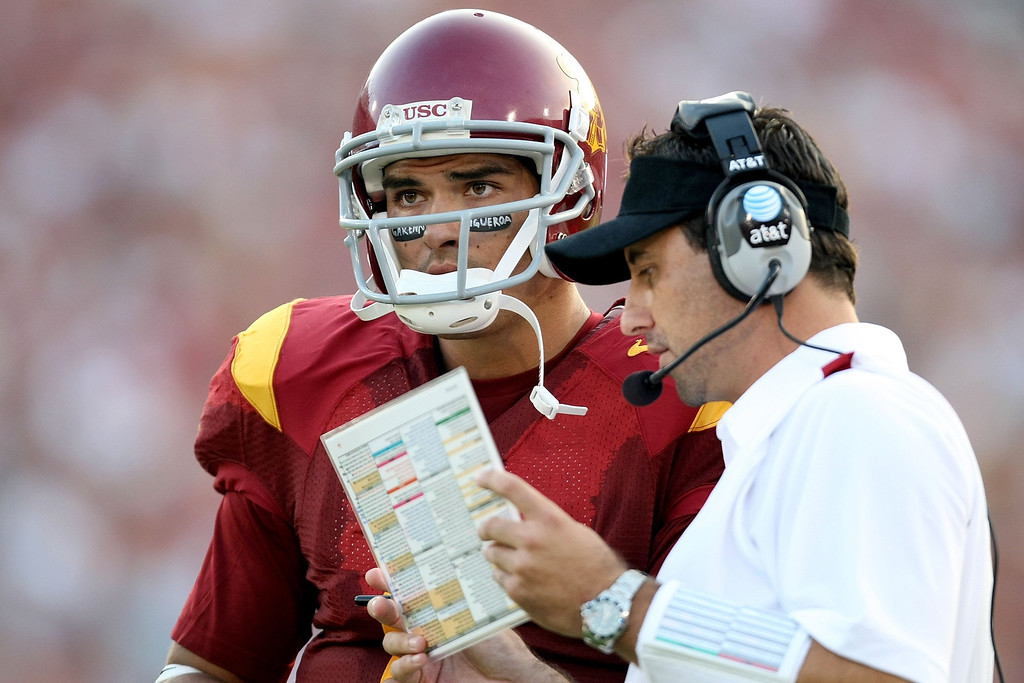 . LOS ANGELES, CA - SEPTEMBER 13:  Mark Sanchez #6 of the USC Trojans talks with assistant coach Steve Sarkisian while taking on the Ohio State Buckeyes during the college football game at the Los Angeles Memorial Coliseum on September 13, 2008 in Los Angeles, California.  (Photo by Harry How/Getty Images)