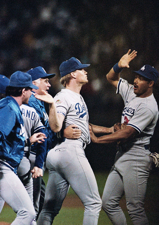 . Los Angeles Dodgers relief pitcher Jay Howell, left, is congratulated by teammate Franklin Stubbs after registering a save against the Oakland As in the fourth game of the World Series at Oakland Coliseum, Wednesday, Oct. 19, 1988, Oakland, Calif. The Dodgers won, 4-3, and lead the series 3-1. (AP Photo/Lennox McLendon)