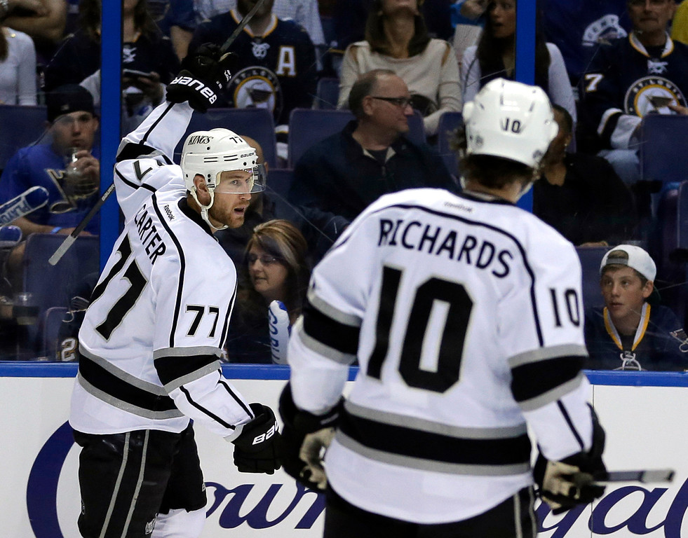 . Los Angeles Kings\' Jeff Carter, left, celebrates as teammate Mike Richards watches after Carter scored during the third period in Game 5 of a first-round NHL hockey Stanley Cup playoff series against the St. Louis Blues Wednesday, May 8, 2013, in St. Louis. (AP Photo/Jeff Roberson)