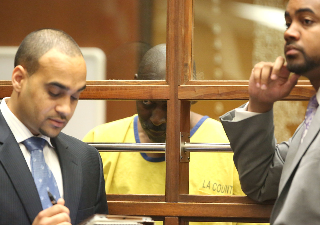 . Actor Michael Jace (C) appears in court for his arraignment on murder charges June 18, 2014 in Los Angeles, California.  Jace is charged with the May 19 shooting death of his wife April Jace.  (Photo by Nick Ut-Pool via Getty Images)