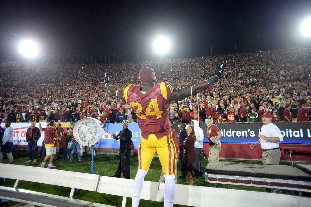 . USC\'s Demetrius Wright #24 hold up his arms after defeating Stanford during their game at the Los Angeles Memorial Coliseum Saturday, November 16, 2013. USC beat Stanford 20-17. (Photos by Hans Gutknecht/Los Angeles Daily News)