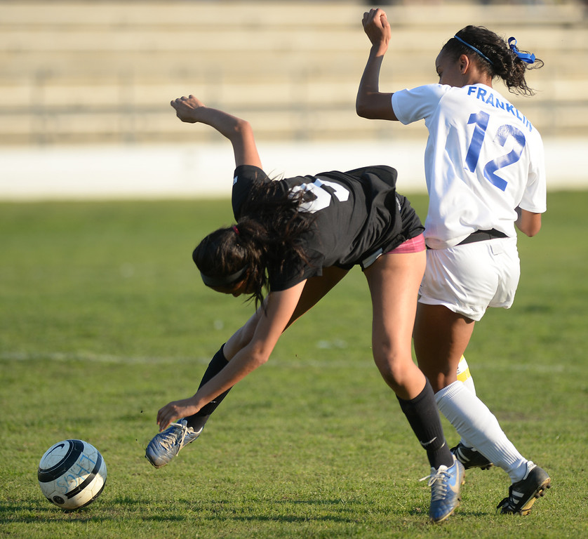 . La Habra\'s Darriell Franklin (#12) and Sunny Hills\' Maribell Morales (#9) collide as they go for the ball in their girls soccer game at La Habra High School on Thursday January 16, 2014. Sunny Hills defeated La Habra 2-0. (Staff Photo by Keith Durflinger/San Gabriel Valley Tribune)
