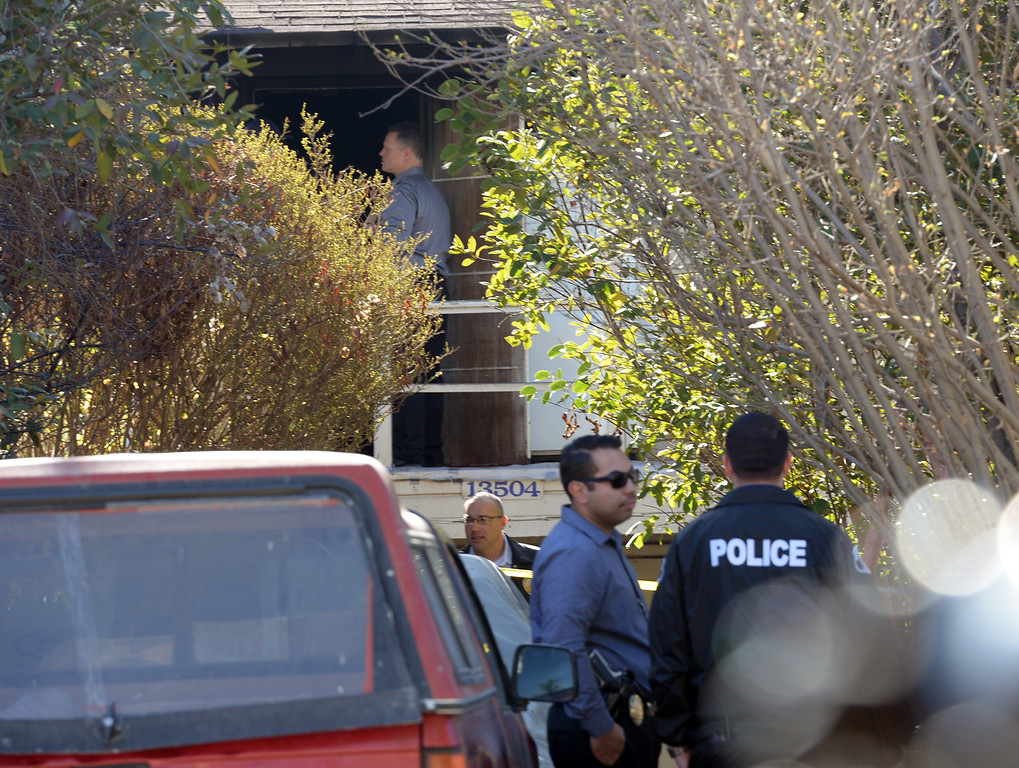 . Whittier Police officers investigate a house fire on the 13500-block of Via Del Palma in Whittier Where two residents were found dead inside on Thursday January 2, 2014. (Staff Photo by Keith Durflinger/Whittier Daily News)