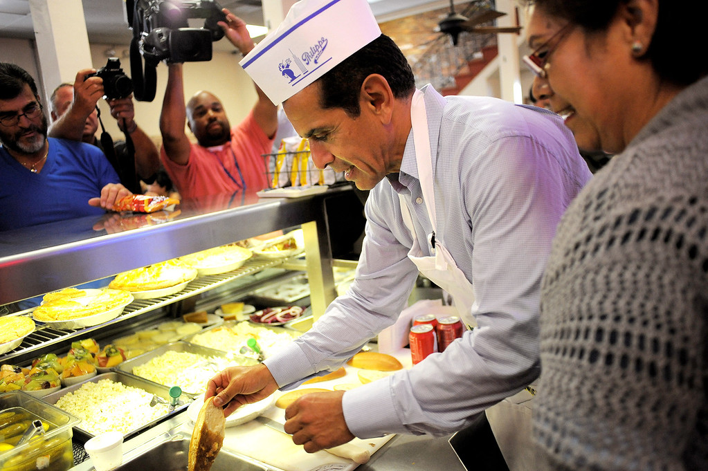 . Mayor Antonio Villaraigosa steps behind the counter at Philippe\'s in Los Angeles, CA June 28, 2013.  Villaraigosa spent the day visiting some of his favorite loactions during his 24-hour goodbye tour.(Andy Holzman/Los Angeles Daily News)