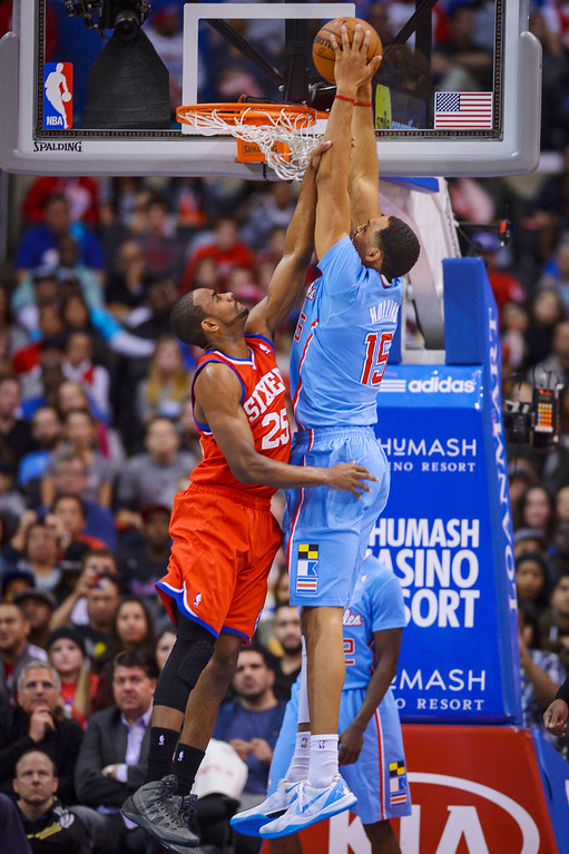 . Clippers� Ryan Hollins puts of two points as 76ers� Elliot Williams fouls on the play at Staples Center Sunday.  The Clippers defeated the 76ers 124-78.  ( Photo by David Crane/Los Angeles Daily News )