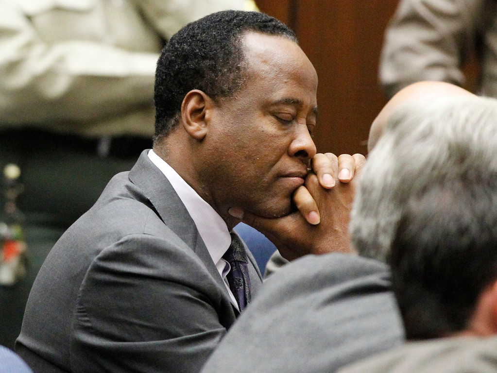 . Dr. Conrad Murray closes his eyes after he was sentenced to four years in county jail for his involuntary manslaughter conviction in the death of pop star Michael Jackson on Tuesday, Nov. 29, 2011 in Superior Court in Los Angeles. (AP Photo/Mario Anzuoni, Pool)