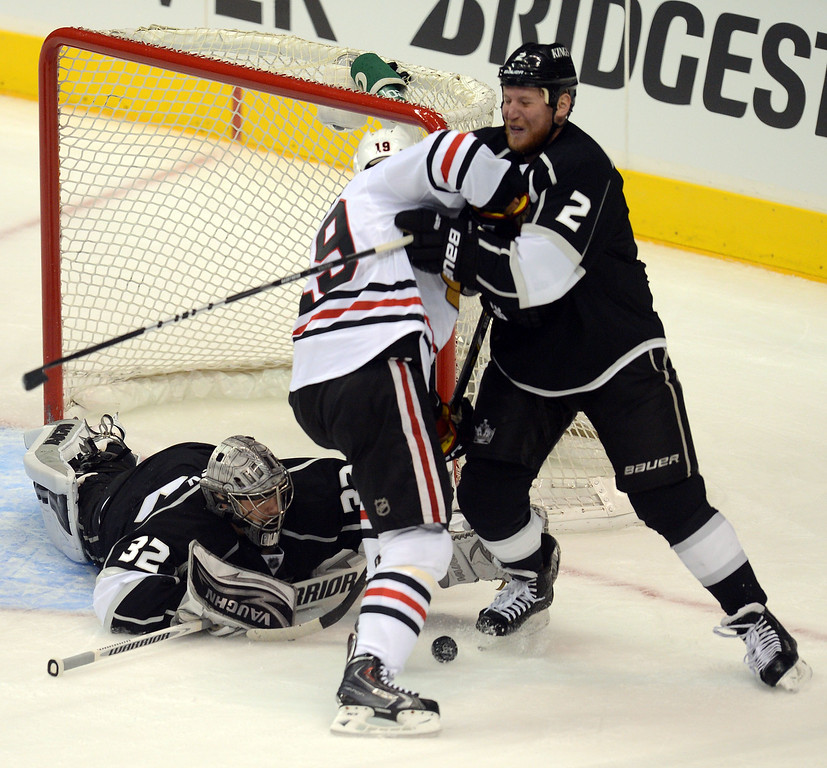 . The Kings\' Jonathan Quick  #32 makes a save as the Blackhawks\'  Bryan Bickell #29 and  Matt Greene #2 fight for position during game 4 of the Western Conference finals at the Staples Center in Los Angeles June 6, 2013. (David Crane/Los Angeles Daily News)