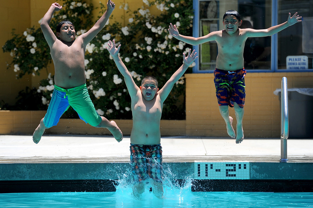 . Children dive into the pool at Lanark Park in Canoga Park, Saturday, June 14, 2014. (Photo by Michael Owen Baker/Los Angeles Daily News)