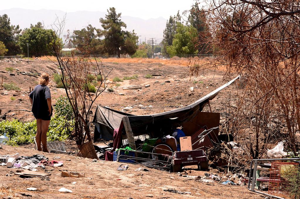 . Donna Bonner, 30, stands outside the homeless camp she\'s been living at in San Bernardino August 14, 2013. GABREL LUIS ACOSTA/STAFF PHOTOGRAPHER.