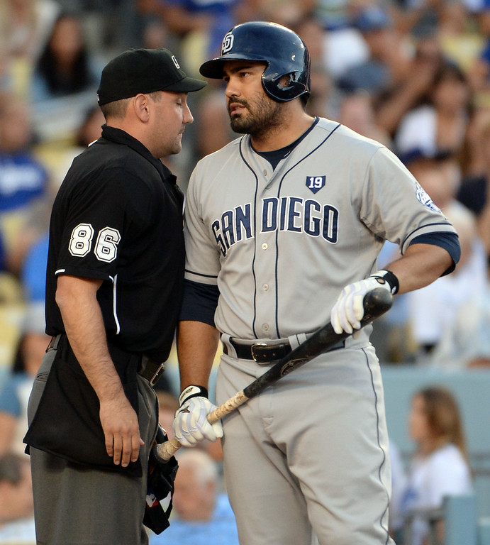 . San Diego Padres\' Carlos Quentin talks with home plate umpire David Rackley (86) after striking out looking in the first inning of a Major league baseball game on Saturday, July 12, 2014 in Los Angeles.   (Keith Birmingham/Pasadena Star-News)