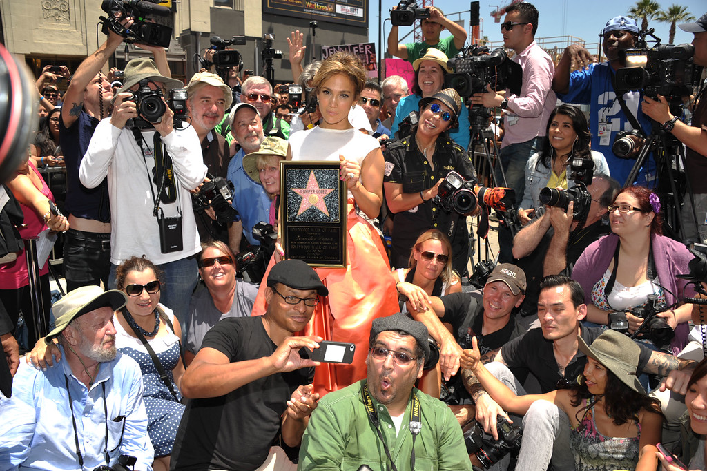 . Jennifer Lopez poses with photographers at her star ceremony on the Hollywood Walk of Fame on Thursday, June 20, 2013 in Los Angeles. (Photo by John Shearer/Invision/AP)