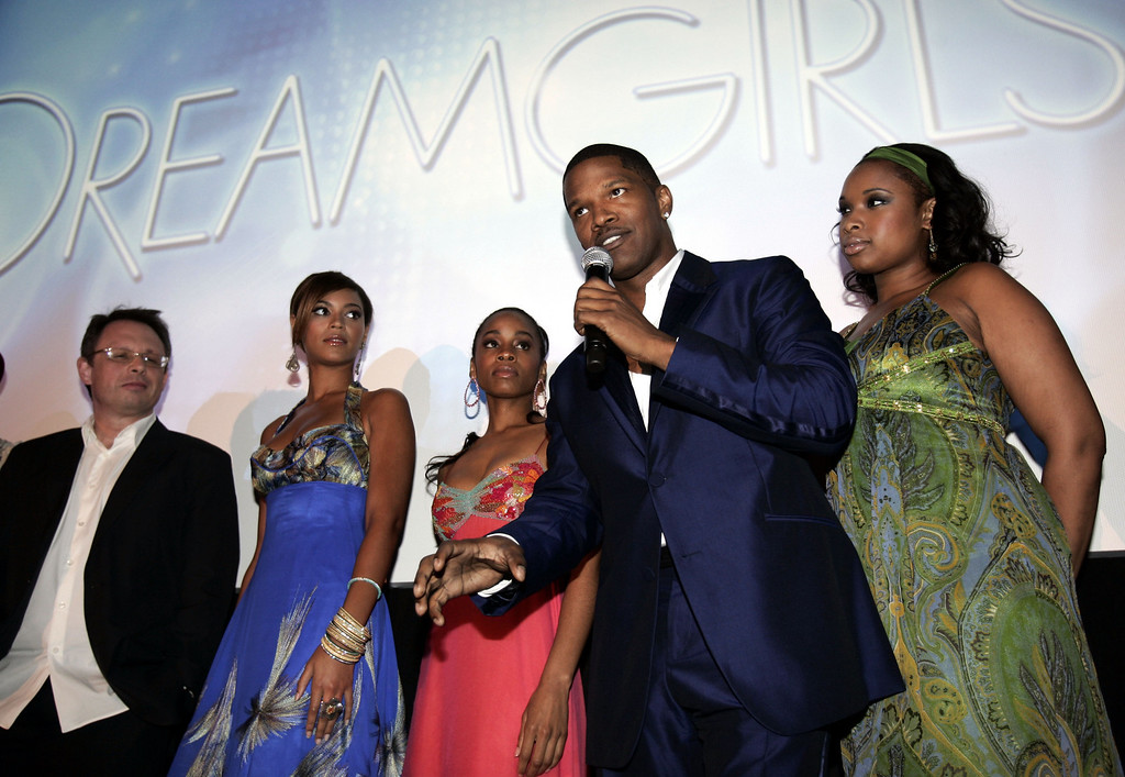 """. Actor Jamie Foxx, second from right, speaks following a preview of the new film \""""Dreamgirls,\"""" as director Bill Condon, left, actress Beyonce Knowles, second from left, actress Anika Noni Rose, third from left, and actress Jennifer Hudson look on in Cannes, southern France, Friday, May 19, 2006. The film will be released during the holiday season in the United Sates.  (AP Photo/Jeff Christensen)"""