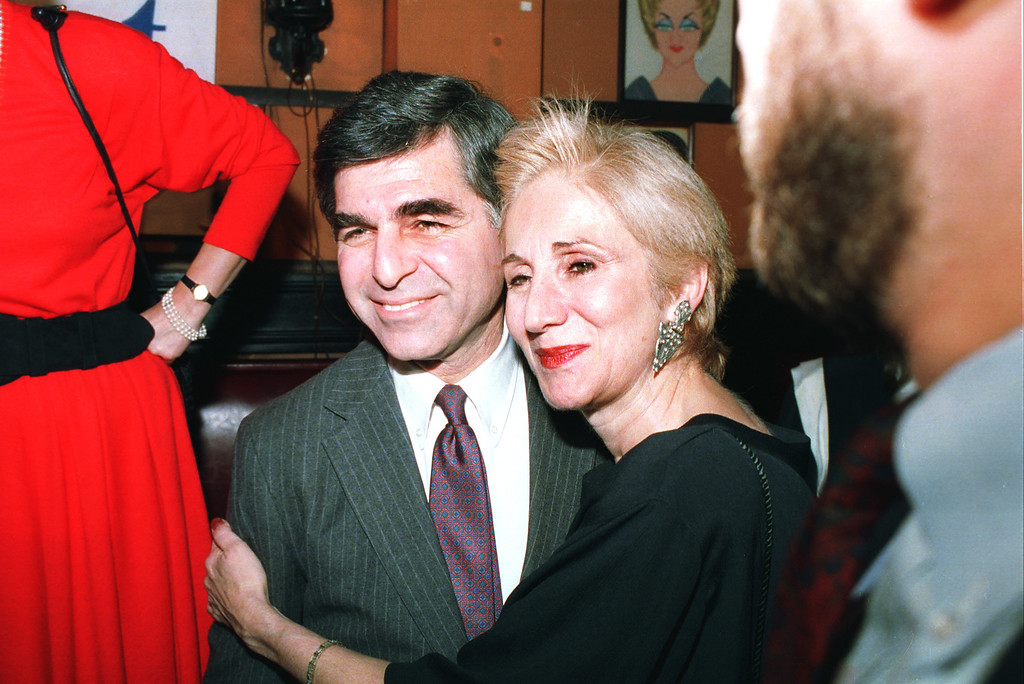. Massachusetts Governor Michael Dukakis poses with cousin Olympia Dukakis during fundraiser at New York\'s Sardi\'s restaurant Feb. 23, 1988. Dinner was to raise funds for Democratic presidential candidate Michael Dukakis. (AP Photo/Ray Stubblebine)