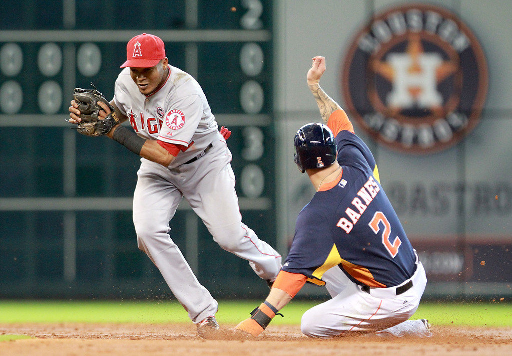. HOUSTON, TX- SEPTEMBER 15: Erick Aybar #2 of the Los Angeles Angels of Anaheim forces out Brandon Barnes #2 of the Houston Astros at second base in the second inning on September 15, 2013 at Minute Maid Park in Houston, Texas. (Photo by Thomas B. Shea/Getty Images)