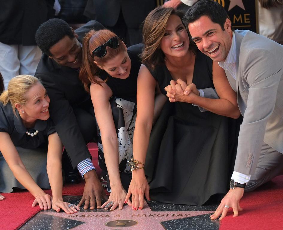 . (L-R) Actors Maria Bello, Blair Underwood, Debra Messing, Mariska Hargitay and Danny Pino pose at a ceremony honoring Hargitay with a star on the Hollywood Walk of Fame on November 08, 2013 in Hollywood, California.           (JOE KLAMAR/AFP/Getty Images)
