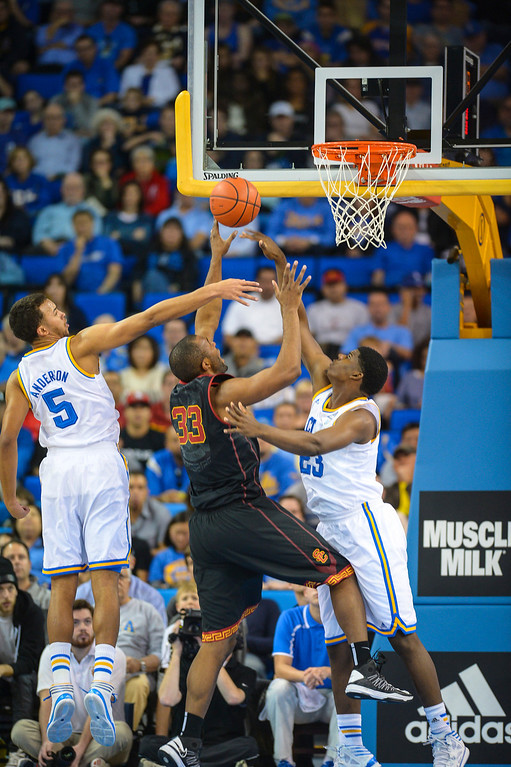 . USC�s D.J. Haley goes for a shot as UCLA�s Tony Parker and Kyle Anderson defend on the play during game action at Pauley Pavilion Sunday, December 5, 2014. UCLA  defeated USC 107-73.  Photo by David Crane/Los Angeles Daily News.