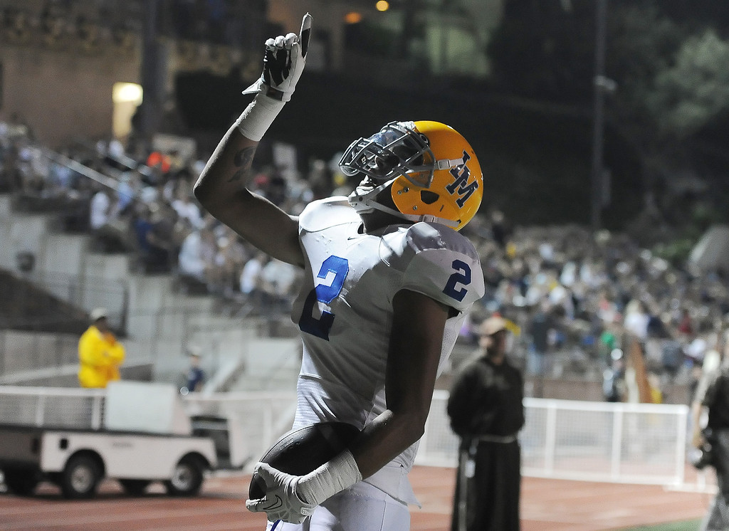 . La Mirada\'s Dallis Todd (C) (2) points to the sky after catching a pass for a touchdown against St. Francis in the first half of a prep football game at St. Francis High School in La Canada, Calif. on Thursday, Sept. 19, 2013.    (Photo by Keith Birmingham/Pasadena Star-News)