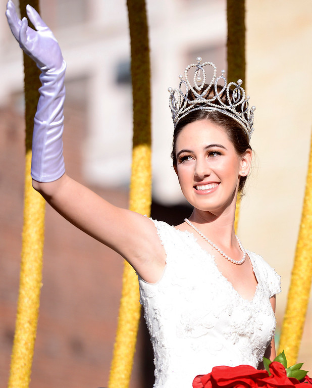 . Rose Queen Ana Marie Acosta rides in the Macy\'s float as it heads down Colorado Boulevard during the125th Rose Parade in Pasadena, CA January 1, 2014. (Photo by Sarah Reingewirtz/Pasadena Star-News)