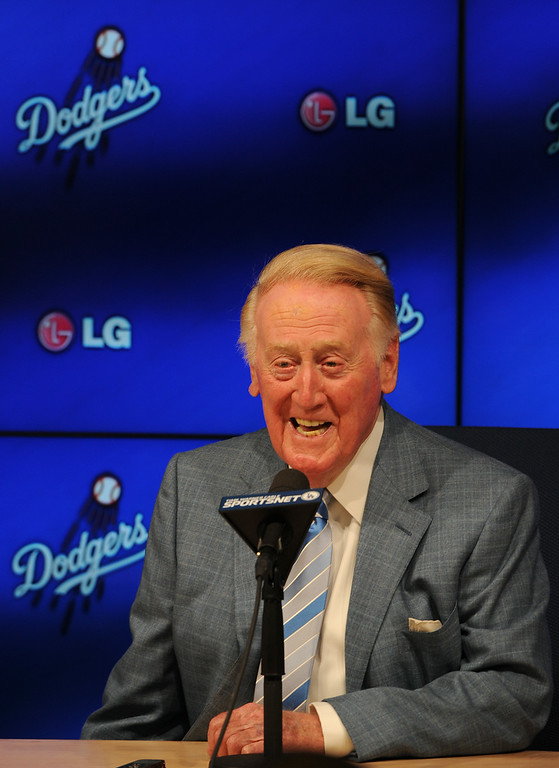 . Hall of Fame broadcaster Vin Scully, an icon in American sports history, will return to the Dodger broadcast booth for an unprecedented 66th season in 2015. The announcement was made by several Dodger players on Dodger Vision during last night�s game against the Atlanta Braves. Los Angeles, CA. 7/30/2014(Photo by John McCoy Daily News)