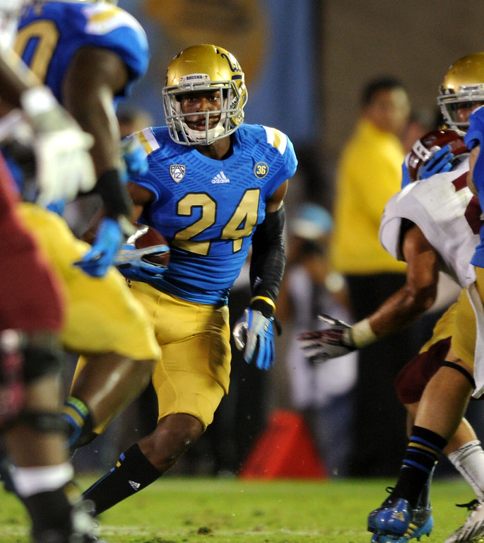 . UCLA DB Ishmael Adams returns an interception 52 yards against New Mexico State in the second quarter, Saturday, September 21, 2013, at the Rose Bowl. (Photo by Michael Owen Baker/L.A. Daily News)