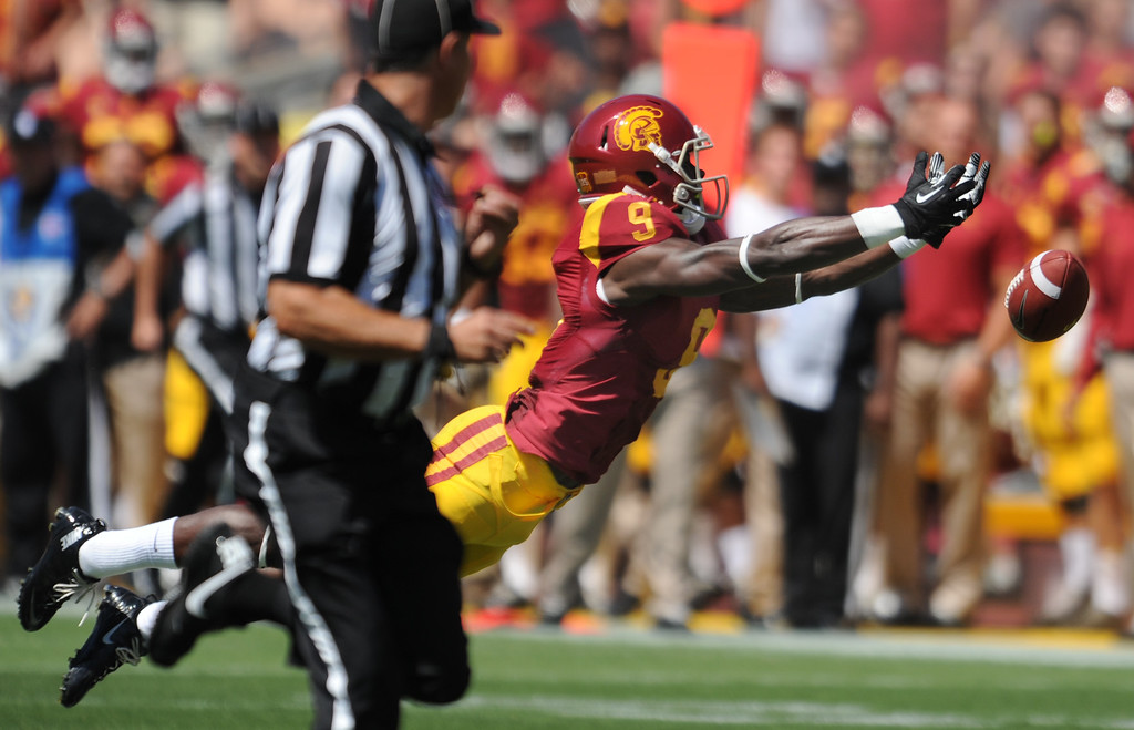 . USC #9 Marqise Lee could not pull in this pass on the first play of the game. USC came out firing the ball as they played Boston College at the Coliseum in Los Angeles, CA. 9/14/2013. photo by (John McCoy/Los Angeles Daily News)