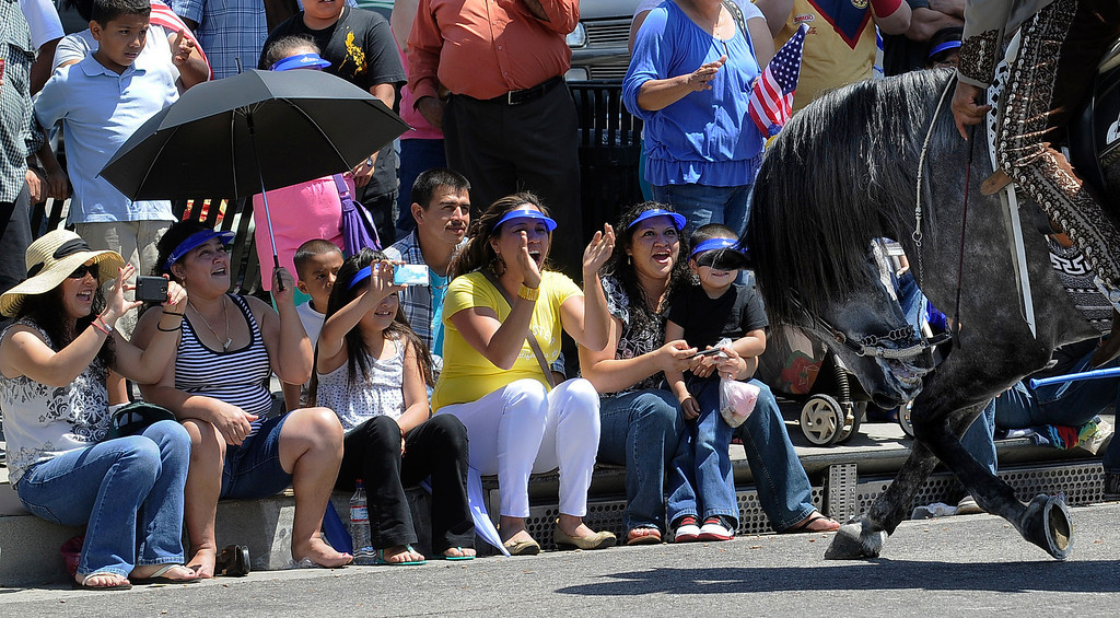 . The crowd shows its appreciation, while a traditional Mexican dancing horse and rider take a bow. The Annual Canoga Park Memorial Day Parade marched down Sherman Way from Owensmouth east to Mason Street where it concluded at the First Baptist Church. Canoga park, CA 5/27/2013(John McCoy/LA Daily News)
