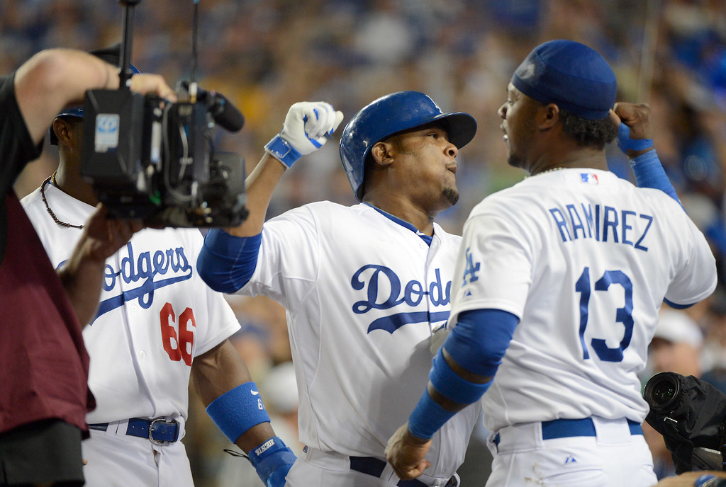 . Los Angeles Dodgers Juan Uribe homered and celebrates with Hanley Ramirez  during game 3 of the NLDS at Dodger Stadium Sunday, October 6, 2013. (Photo by David Crane/Los Angeles Daily News)