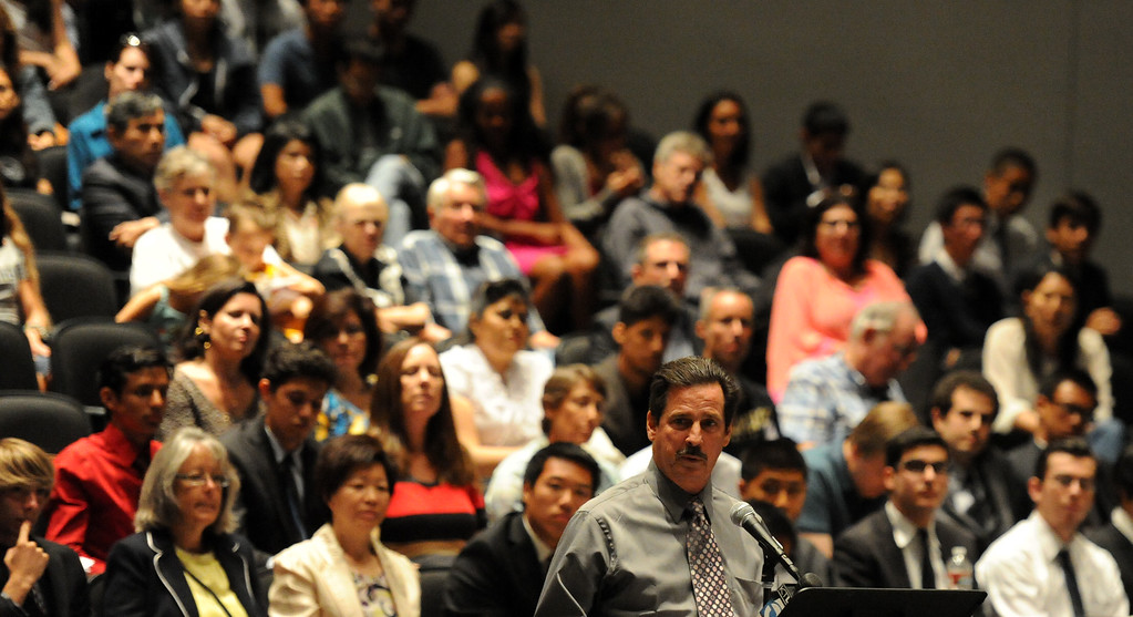 . Former cross-country coach James O\'Brien speaks about wanting to have his job back to over 200 people that crowded the Arcadia Unified School District Performing Arts Center as a show of support for fired Arcadia High School cross-country coach James O\'Brien during a Arcadia Unified School District Board of Education meeting on Tuesday, July 23, 2013 in Arcadia, Calif. O\'Brien, led the team to two time state and national championships.