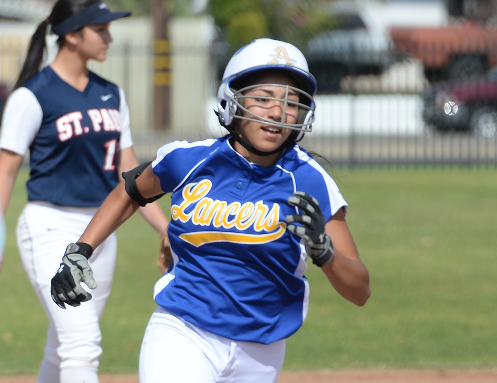 . Bishop Amat\'s Alyssa Barrera (#16) rounds third base after hitting her first homerun of the game as they play St. Paul in their Del Rey League girls softball game at York Field in Whittier on Thursday March 27, 2014. St. Paul defeated Bishop Amat 7-5. (Staff Photo by Keith Durflinger/Whittier Daily News)