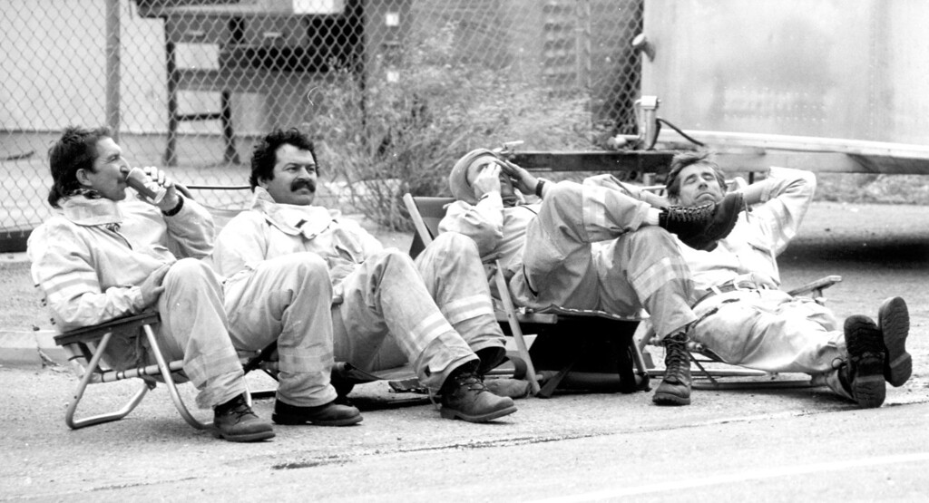 . Firefighters from San Juan Capistrano Fire Department take a break while battling one of the many recent Southland blazes.  (11/3/93)   Los Angeles Daily News