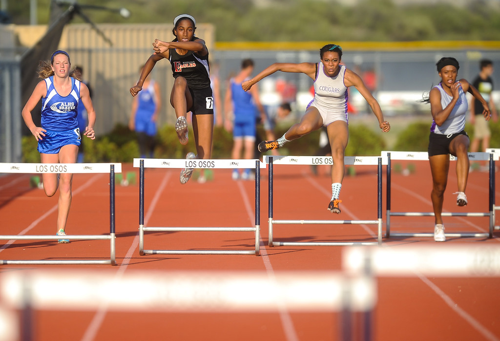 . Girls compete in the 300 Meter Hurdles event during the Baseline League Track & Field Championship Finals hosted at Los Osos High School in Rancho Cucamonga on Friday, May 3, 2013. (Rachel Luna / Staff Photographer)