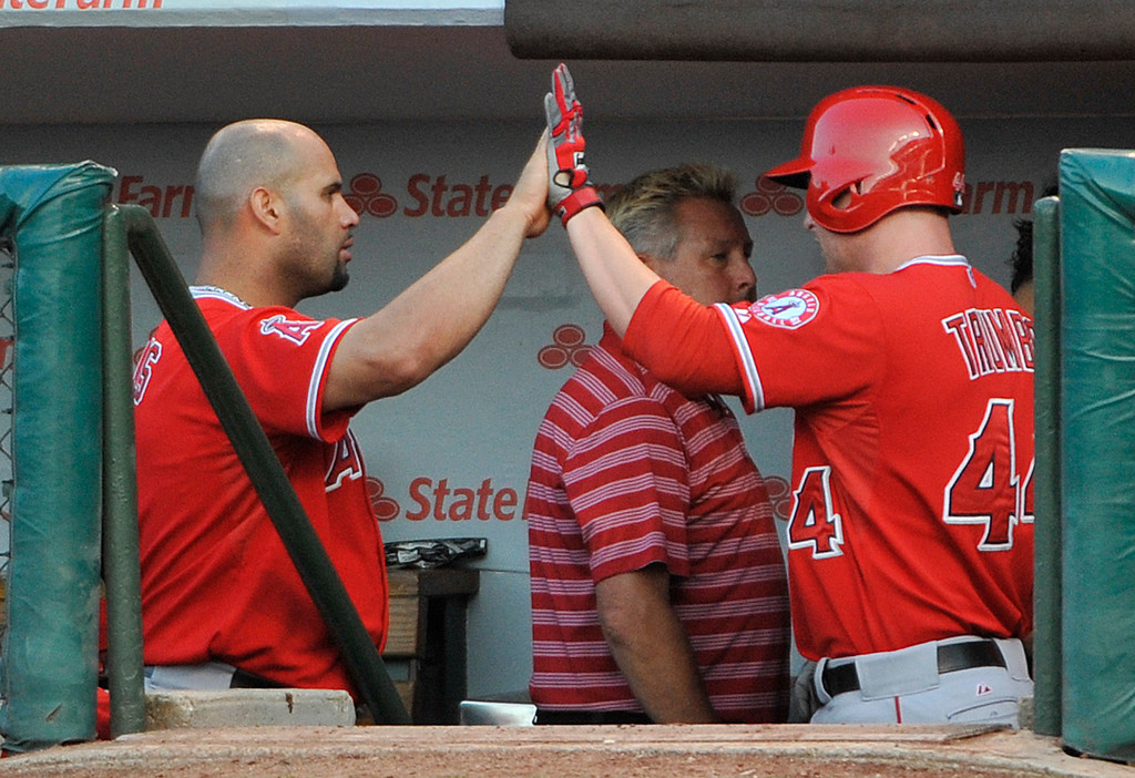 . CHICAGO, IL - JULY 10: Mark Trumbo #44 of the Los Angeles Angels of Anaheim is greeted by Albert Pujols #5  after hitting a home run against the Chicago Cubs during the first inning on July 10, 2013 at Wrigley Field in Chicago, Illinois. (Photo by David Banks/Getty Images)