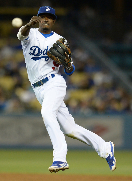 . Dee Gordon makes a throw to 1st base in the 6th inning. The Dodgers defeated the Colorado Rockies at 4-2 Dodger Stadium in Los Angeles, CA. 6/18/2014(Photo by John McCoy Daily News)