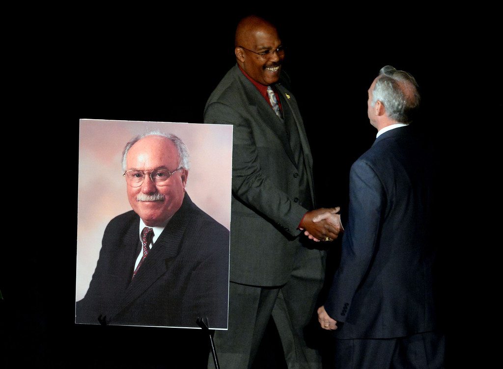 . Retired Pasadena Fire Dept. Capt. Byron Brown, left, shakes hands with Lew Stone, Secretary Treasurer California Professional Fire Fighters Associations during a celebration of life service for former Pasadena Fire dept. Capt. and California State fire marshall, John Tennant at the Pasadena Civic Auditorium in Pasadena, Calif., on Wednesday, Feb. 5, 2014. (Keith Birmingham Pasadena Star-News)
