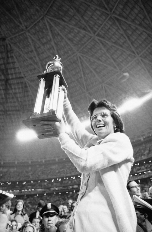 . Billie Jean King holds the winner?s trophy high in the air after she defeated Bobby Riggs in the $100,000 winner-take-all tennis championship in the Astrodome in Houston, Texas on Sept. 20, 1973. Ms. King set Riggs down 6-4; 6-3; 6-3. (AP Photo)