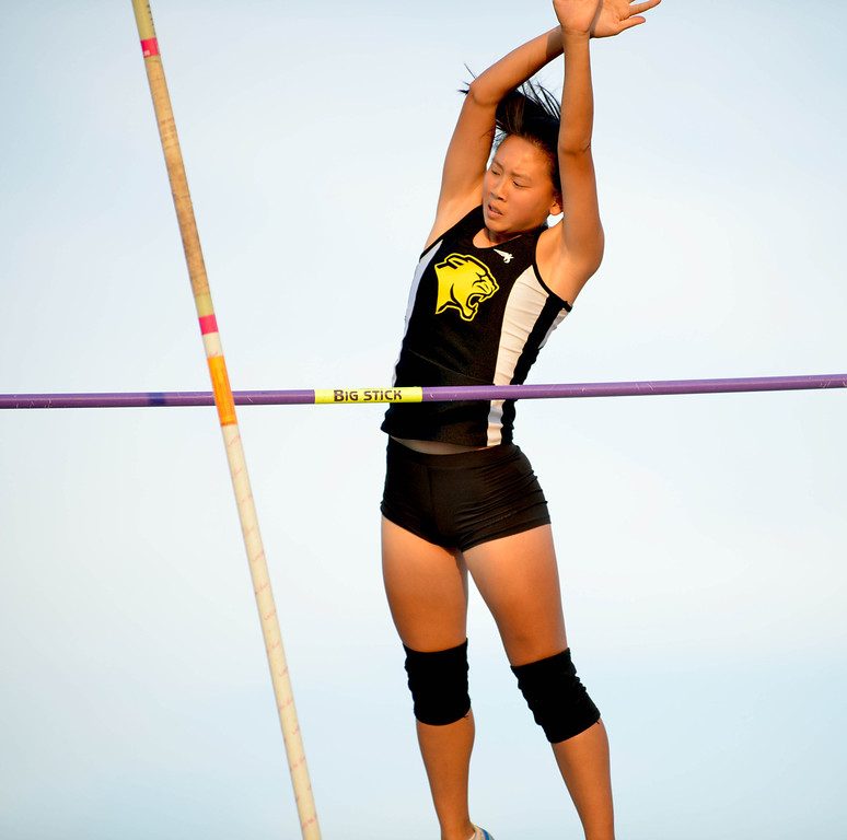. 05-03-2013-(LANG Staff Photo by Sean Hiller)-  The Bay League track and field finals Friday night at Mira Costa High School. Erika Woo of Peninsula won the girls varsity pole vault.