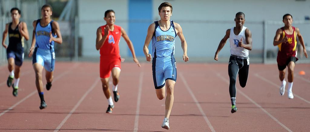 . Walnut\'s Matt Magallanez wins the 400 meter run during the Hacienda League track finals in Walnut, Calif., on Thursday, May 8, 2014.  (Keith Birmingham Pasadena Star-News)