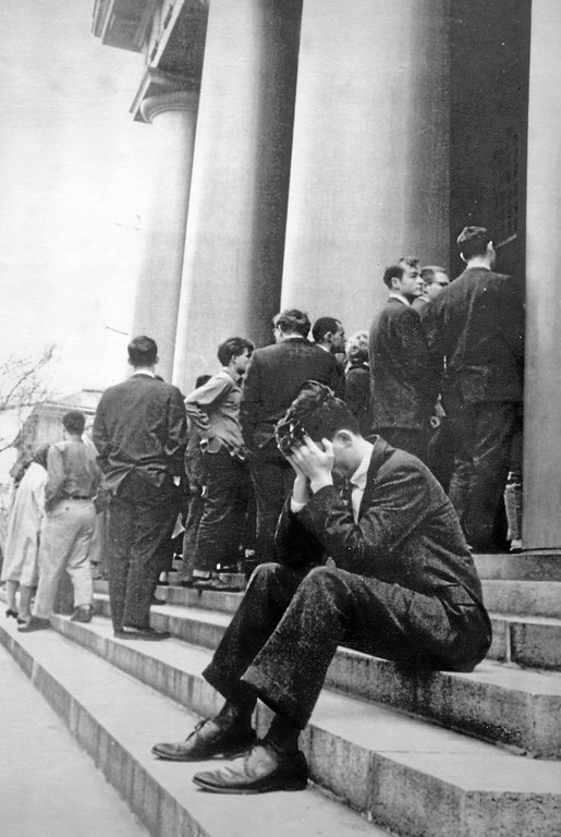 . A Harvard student buries his face in his hands as he sits on steps of Memorial Church in Harvard Yard in Cambridge, MA, November 23, 1963, during services for JFK. (Associated Press)