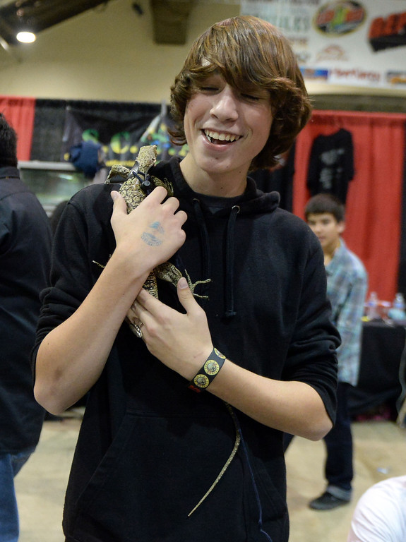 ". Matthew Hinkley of Oxnard smiles as he holds ""Dexter\"" the Quince monitor lizard during the Reptile Super Show which is the world\'s largest reptile show with more than 500 tables of rare & unique animals including lizards, turtles, frogs, supplies at the Fairplex in Pomona, Calif., on Saturday, Jan.4, 2014.   (Keith Birmingham Pasadena Star-News)"