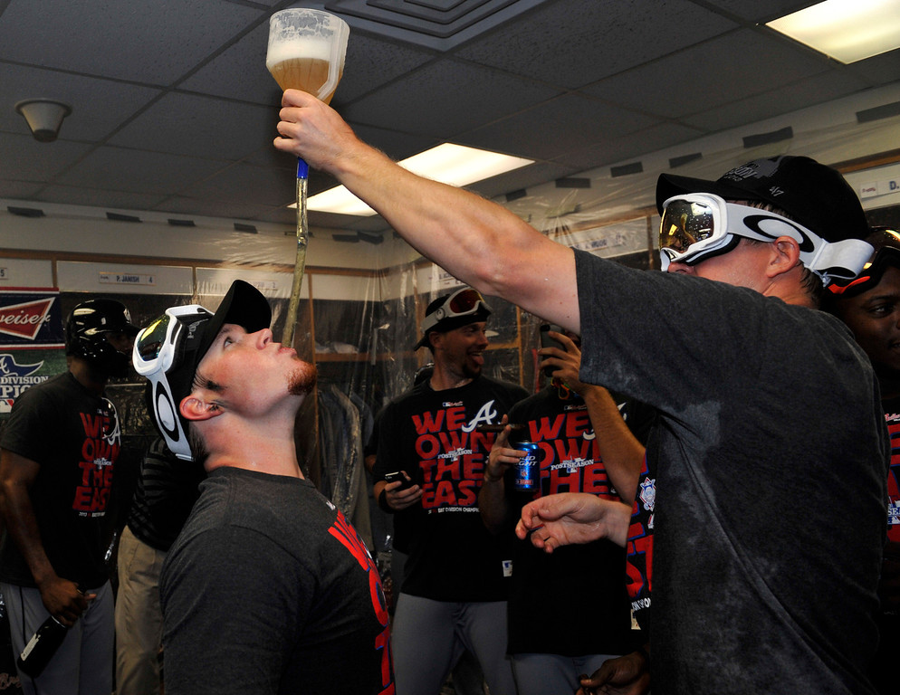 . CHICAGO, IL - SEPTEMBER 22: Craig Kimbrel #46 of the Atlanta Braves drinks beer and celebrates with his teammates after clinching the National League East Division Championship on September 22, 2013 at Wrigley Field in Chicago, Illinois.  (Photo by David Banks/Getty Images)