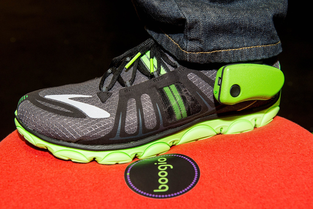 . Jose Torres demonstrates Boogio, a tech product worn in shoes, at Electronic Entertainment Expo in Los Angeles on Tuesday, June 10, 2014. (Photo by Watchara Phomicinda)