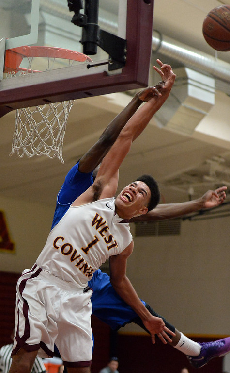 . Diamond Ranch\'s Ernest Ugoagu blocks the shot of West Covina\'s Michael Fallon (1) in the first half of a prep basketball game at West Covina High School in West Covina, Calif., on Wednesday, Jan. 8, 2014. (Keith Birmingham Pasadena Star-News)