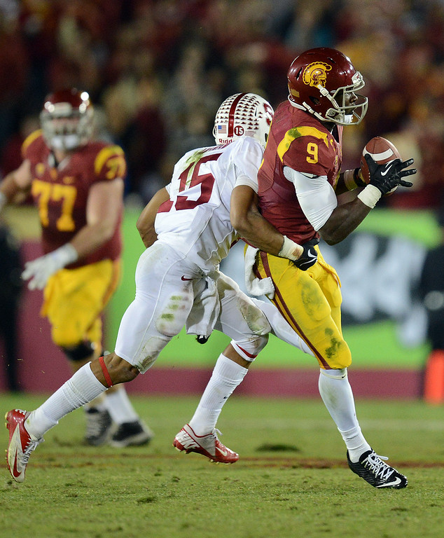 . USC�s Marqise Lee #9 hauls in a catch for a first down on fourth down late in the fourth quarter during their game against Stanford at the Los Angeles Memorial Coliseum Saturday, November 16, 2013. USC beat Stanford 20-17. (Photos by Hans Gutknecht/Los Angeles Daily News)