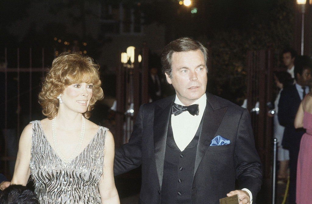 . Actors Robert Wagner and Jill St. John are shown at Universal Amphitheater in Los Angeles, while watching Frank Sinatra perform, July 30, 1982. (AP Photo/Reed Saxon)