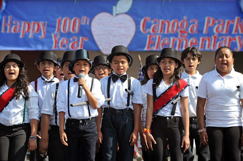 . Students perform a song during the Canoga Park Elementary School Centennial Celebration May 17, 2013.  Live musicians, performances by students, an LAPD helicopter flyover and speakers were featured during the event in Canoga Park, CA Friday.(Andy Holzman/Staff Photographer)