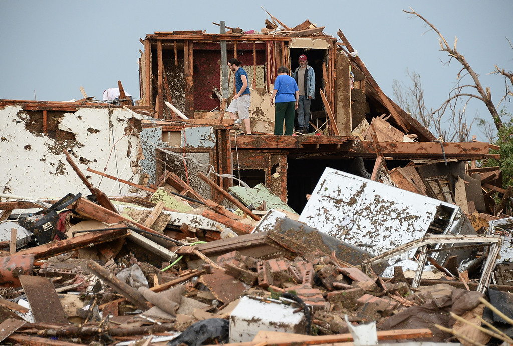 . Local Neighbors on the 2nd floor of their home look for belongings.  