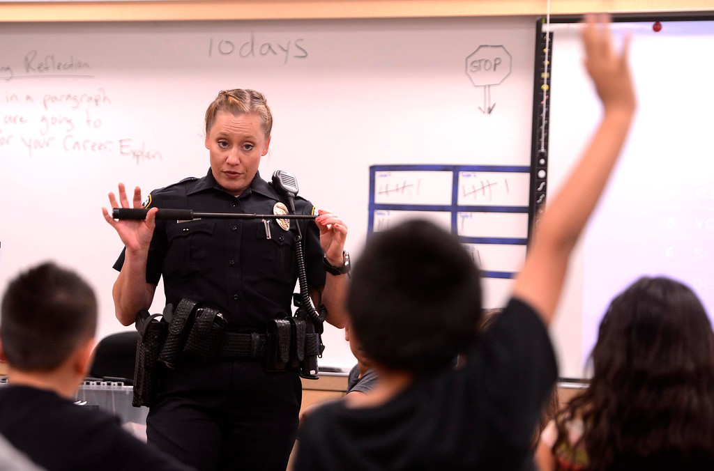 . BNSF Railway Police Senior Special Agent Aimee Schmidt talks to third graders about her job during the final day of the 19th Annual Career Awareness Week at Lankershim Elementary School in Highland June 6, 2013.  GABRIEL LUIS ACOSTA/STAFF PHOTOGRAPHER.