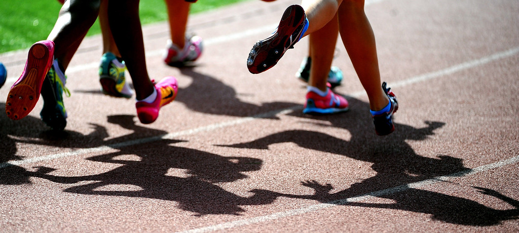 . Runners shadows during the 1600 meter race during the Hacienda League track finals in Walnut, Calif., on Thursday, May 8, 2014.  (Keith Birmingham Pasadena Star-News)