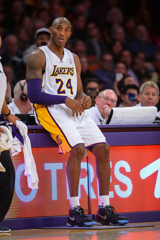. Lakers� Kobe Bryant waits to take the floor during second half action at Staples Center Sunday, December 8, 2013.  Lakers lost to the Raptors 94-106 as Bryant returned to action for the first time this season.  ( Photo by David Crane/Los Angeles Daily News )