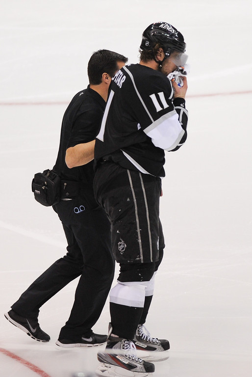 . The Kings\' Anze Kopitar leaves the ice after taking a puck in the face during the third period, Thursday, May 16, 2013, at Staples Center. (Michael Owen Baker/Staff Photographer)